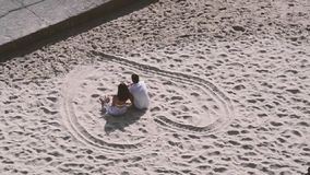 Couple at the beach stock video