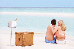 Couple On Beach With Luxury Champagne Picnic Royalty Free Stock Images