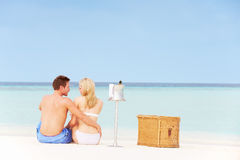 Couple On Beach With Luxury Champagne Picnic Royalty Free Stock Photography