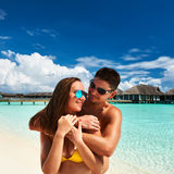 Couple on a beach at Maldives. Couple on a tropical beach at Maldives Royalty Free Stock Images