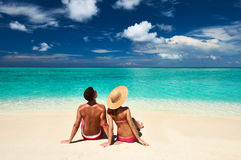 Couple on a beach at Maldives Stock Photos