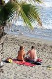 Couple on beach, Marbella, Spain. Royalty Free Stock Image