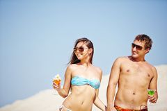Couple at beach party Royalty Free Stock Image
