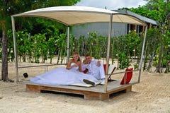 Couple in a beach pavillion Royalty Free Stock Photo