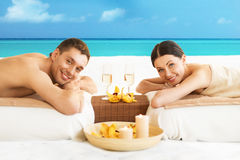 Couple on the beach. Picture of couple on the beach drinking champagne royalty free stock photography
