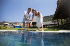 A couple at the beach pool Stock Photos