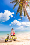 Couple on the beach with retro bike Royalty Free Stock Photography