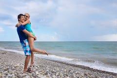 Couple on the beach by sea Stock Photos