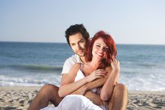 Couple at the beach seducing each other Stock Image