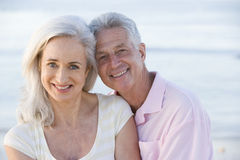 Couple at the beach smiling Stock Images