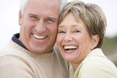 Couple at the beach smiling Royalty Free Stock Photography