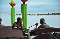 A couple at the beach smoking a hookah local Royalty Free Stock Photography