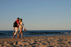 Couple during a beach stroll.  Royalty Free Stock Photography