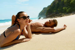 Couple On Beach In Summer. Romantic People On Sand At Resort. Couple On Beach In Summer. Romantic People In Love Relaxing On Sand, Enjoying Sea View. Happy Man Royalty Free Stock Images