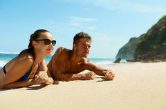 Couple On Beach In Summer. Romantic People On Sand At Resort royalty free stock images