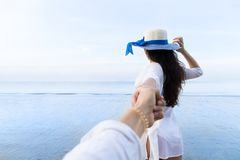 Couple On Beach Summer Vacation, Beautiful Young Girl Hold Male Hand People Looking Sea. Ocean Holiday Travel Stock Photography