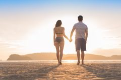 Couple Beach Summer Vacation, Man Woman Yjlding Hands Sunset Beautiful Young Guy Girl Back Rear View Stock Image