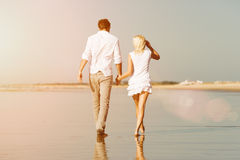 Couple on the beach in summer vacation Stock Photos