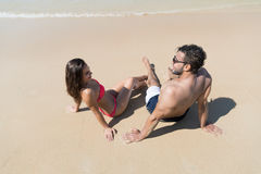 Couple On Beach Summer Vacation, Young People Sitting On Sand, Man Woman Sea Ocean Stock Photo