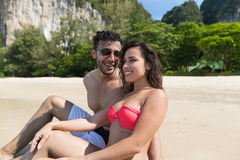 Couple On Beach Summer Vacation, Young People Sitting On Sand, Man Woman Sea Ocean Royalty Free Stock Photos