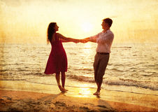 Couple at the beach in sunset. Royalty Free Stock Images