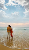 Couple on the beach at sunset Stock Image