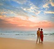 Couple on the beach at sunset. Couple of adults on ocean shore at sunset Stock Photo