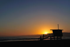 Couple on Beach at Sunset Stock Image
