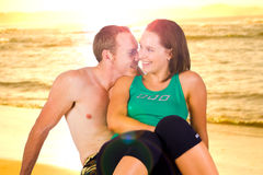 Couple on beach at sunset Stock Photography