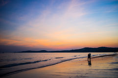 Couple On The Beach At Sunset #2 Royalty Free Stock Images