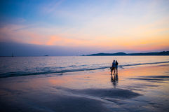 Couple On The Beach At Sunset Royalty Free Stock Images