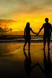 Couple at the beach for sunset Stock Photos