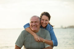 Couple on  beach during  sunset Royalty Free Stock Photos