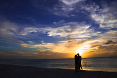 Couple on Beach at Sunset Royalty Free Stock Photography