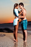 Couple on the beach at sunset Royalty Free Stock Photo