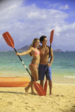 Couple at the beach with their kayak Stock Photography