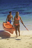 Couple at the beach with their kayak Royalty Free Stock Photo