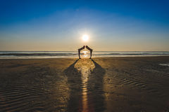 Couple on the beach. In time sunrise or sunset Royalty Free Stock Photography