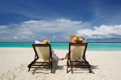 Couple on a beach. Couple on a tropical beach at Maldives royalty free stock photos