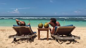 Couple on beach at tropical resort