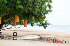 Couple on the beach at tropical resort Travel magazine concept Stock Photography