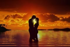 Couple at beach under sunset. Loving couple at beach under sunset Royalty Free Stock Images
