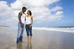 Couple on beach vacation. Man and a woman on a beach Royalty Free Stock Image