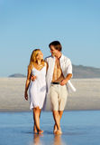 Couple beach walk Royalty Free Stock Image