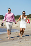 Couple on beach Stock Image