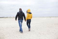 Couple at the beach in winter Royalty Free Stock Photo
