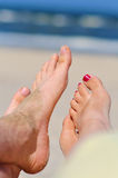 Couple at a beach - bare feet. Couple at a beach - woman's and man's bare feet Royalty Free Stock Image