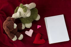 Couple Bears and love heart on Valentines Day. Bear holding and heart shaped  on red background Royalty Free Stock Photo