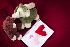 Couple Bears and love heart on Valentines Day. Bear holding and heart shaped  on red background Stock Images