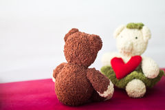 Couple Bears and love heart on Valentines Day. Bear and a heart shaped with white wall background Royalty Free Stock Images